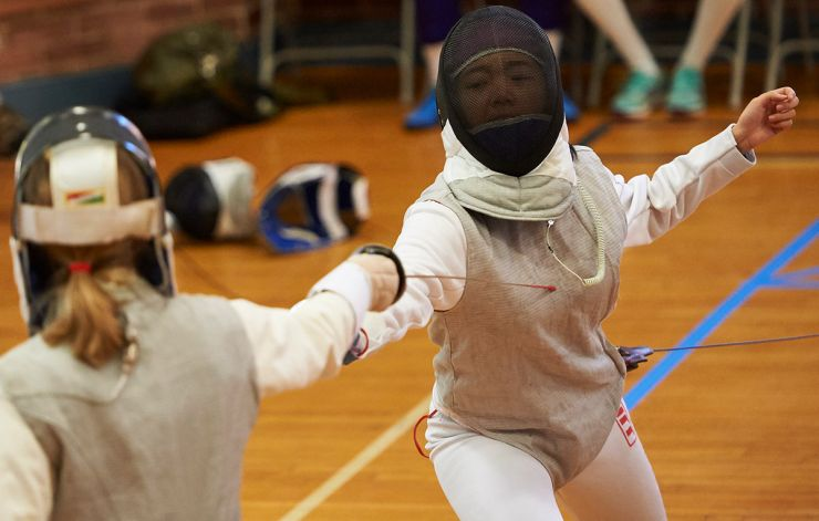 Fencing - academy student making contact