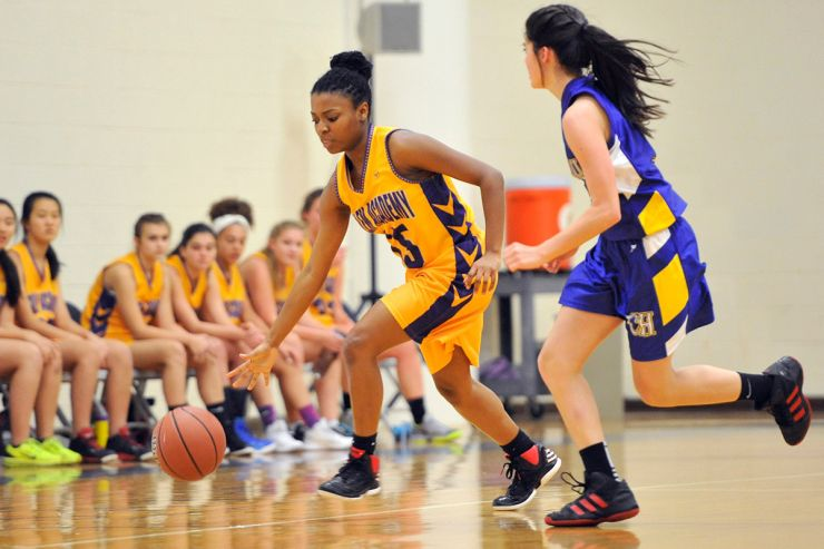 Basketball - Academy student breaks away from her defender