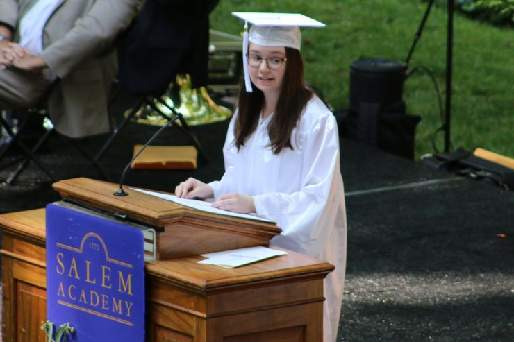 Honors & Awards - student giving speech at graduation